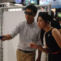 A demonstration of the Move version of the game at Tokyo Game Show, held in September at Makuhari Messe.