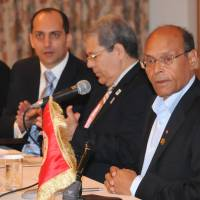 Building bridges:  Tunisian President Moncef Marzouki (right) and  Tunisian Foreign Minister Othman Jerandi (second from right) attend a roundtable meeting with Japanese businesspeople in  Yokohama on Sunday. | SATOKO KAWASAKI