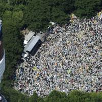 Opposition continues: Thousands of opponents of nuclear power gather near Tokyo Tower in Minato Ward to stage a march Sunday toward the Diet. | KYODO