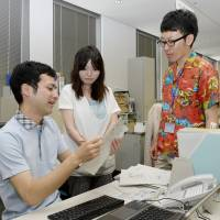 Chilling: Officials work in light clothing Monday at the Environment Ministry as the government's Super Cool Biz drive to promote energy conservation kicks off. | KYODO