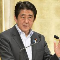 Broad strokes: Prime Minister Shinzo Abe unveils his structural reform plan in a speech Wednesday at a Tokyo hotel.  | KYODO