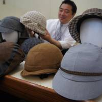 Street fashion: Hatlike cycling helmets developed by Nippon Parade are on display recently in Tokyo. They are generating interest from riders concerned about safety but who hesitate to wear helmets designed for competition. | KYODO