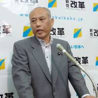Hanging it up: Shinto Kaikaku (New Renaissance Party) leader Yoichi Masuzoe faces reporters Friday at the Diet to announce he won't seek re-election in July's Upper House poll. | KYODO