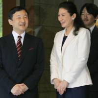 Solo trip: Crown Prince Naruhito leaves the Togu Palace in Tokyo for an official trip to Spain Monday, as his wife, Crown Princess Masako, and his brother, Prince Akishino, see him off.   | POOL