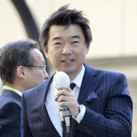 No invite: Nippon Ishin no Kai (Japan Restoration Party) co-chief and Osaka Mayor Toru Hashimoto makes a stump speech on his home turf in December. | KYODO