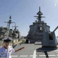 Ship-shape: A Maritime Self-Defense Force official shows off the Aegis-equipped destroyer Atago to the press at U.S. Naval Base San Diego on Monday. The ship is participating in a bilateral drill in California to practice the retaking of remote islands. | KYODO