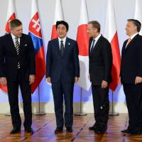 Atomic interests: Slovakian Prime Minister Robert Fico, Prime Minister Shinzo Abe, Polish Prime Minister Donald Tusk, Hungarian Prime Minister Viktor Orban and Czech Prime Minister Petr Necas chat Sunday at the Royal Castle in Warsaw during a summit focused mainly on promoting Japanese nuclear technologies. | AFP-JIJI