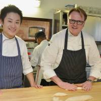 On the ground floor: Kei Kitagawa, who works at Ca'Matilde in northern Italy, pauses for a moment with chef Andrea Incerti Vezzani in the restaurant's kitchen on May 2. | KYODO
