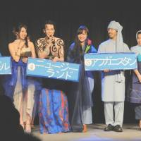 Catwalk: Twenty student models in ethnic attire take the stage in front of 700 youngsters, mostly university students, in an event held in Tokyo's Harajuku district Thursday to raise awareness of the plight of asylum seekers. | SATOKO KAWASAKI