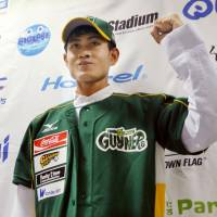 Southpaw: Zaw Zaw Oo, 23, a Myanmar national who has joined the Kagawa Olive Guyners team in the independent Shikoku Island League Plus, appears before the media in Takamatsu on Thursday. | KYODO