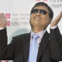 Democracy dream: Chinese human rights advocate Chen Guangcheng, who has lived in the United States since leaving China in 2012, attends a news conference in Taipei on Monday. | KYODO