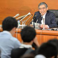 Staying cool: Bank of Japan Gov. Haruhiko Kuroda fields questions after the central bank concluded its two-day Policy Board meeting in Tokyo on Tuesday.  | AFP-JIJI
