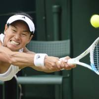Inspiration for all ages: Kimiko Date-Krumm plays a shot during her Wimbledon singles match against Romania's Alexandra Cadantu on  Thursday. The 42-year-old Date-Krumm won 6-4, 7-5, becoming the oldest woman to advance to the Grand Slam tournament's third round since the Open era began in 1968.  | KYODO