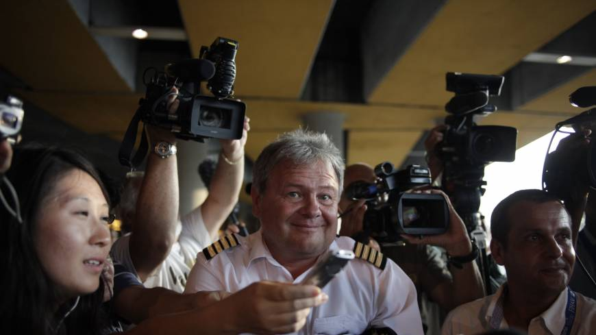 Welcome to Cuba: Journalists surround an Aeroflot flight crew member at Havana's Jose Marti International Airport on Monday. Confusion over the whereabouts of Edward Snowden grew after flight SU150 flew from Moscow to Cuba with an empty seat booked in the former NSA contractor's name.  | AP
