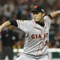 Century man: Yomiuri's Tetsuya Utsumi delivers a pitch during the Giants' 11-3 victory over the Hawks on Sunday. Utsumi won the decision for his 100th career win. | KYODO