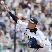 That winning feeling: Chiba Lotte pitcher Yuji Nishino delivers against the Fighters during the Marines' 2-1 win on Sunday. | KYODO