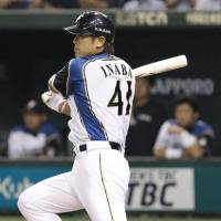 The turning point: Fighters captain Atsunori Inaba strokes a two-run single in the eighth inning to lead Hokkaido Nippon Ham to a 4-2 win over the Fukuoka Softbank Hawks on Tuesday at Tokyo Dome.