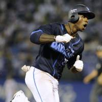 Fired up: The BayStars' Nyjer Morgan rounds the bases after slugging a three-run shot in the fourth inning against the Swallows at Jingu Stadium on Thursday. Yokohama defeated Tokyo Yakult 7-6. | KYODO