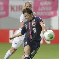 Slippery conditions: Japan captain Aya Miyama takes a shot against New Zealand on Thursday in an international friendly in Tosu, Saga Prefecture. The teams settled for a 1-1 draw. | KYODO