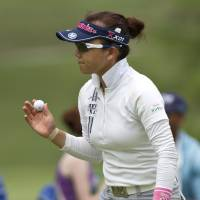 Steady as she goes: Chie Arimura walks off the 18th green after the second round of the NW Arkansas Championship. | AP