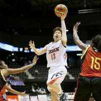 Staying aggressive: Japan guard Yuko Oga drives to the basket on Friday night against Mozambique at Sendai's Xebio Arena. The Japan women's national team whipped Mozambique 105-39 in the first of three games between the clubs through Sunday. | KYODO