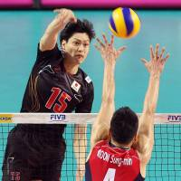 In position: Japan's Daisuke Yako spikes the ball against South Korea's Moon Sung-min during the teams' FIVB World League Pool C match in the intercontinental round on Saturday. South Korea defeated visiting Japan in four sets.   KYODO