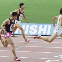 The quickest: Keio University's Ryota Yamagata (right) wins the men's 100-meter race at the 97th Japan Athletics National Championships on Saturday at Ajinomoto Stadium. Yamagata finished the race in 10.11 seconds. | KYODO