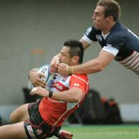 Force of nature: Japan captain Toshiaki Hirose scores a try during the Brave Blossoms' 38-20 win over the United States in the Pacific Nations Cup in Tokyo on Sunday. | KYODO