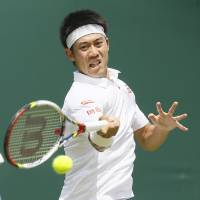 To boldly go: Kei Nishikori plays a shot during his 6-2, 6-4, 6-3 win over Matthew Ebden at Wimbledon on Tuesday. | AP