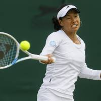 Forever young: Kimiko Date-Krumm plays a shot from Romania's Alexandra Cadantu during their second-round match at Wimbledon on Thursday. Date-Krumm won 6-4, 7-5. | AP