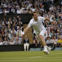 Cruise control: Andy Murray plays a shot from Spain's Tommy Robredo in their third-round match at Wimbledon on Friday. | AFP-JIJI