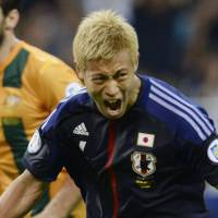 National euphoria: Japan's Keisuke Honda celebrates after scoring a match-tying goal against Australia in Tuesday's World Cup qualifier at Saitama Stadium. With a 1-1 draw in its Asia Group B match, Japan became the first nation to qualify for the 2014 World Cup in Brazil. | KYODO