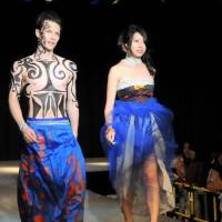 A couple representing New Zealand model in the 'Why Blue' fashion show for World Refugees Fashion, at Laforet Museum Harajuku.    SATOKO KAWASAKI