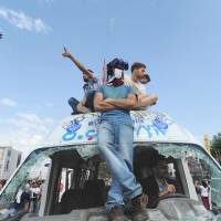 Driving home a message: Protesters gather in Istanbul's Taksim Square on Sunday, a day after police pulled out following violent clashes between demonstrators and authorities. | AFP-JIJI