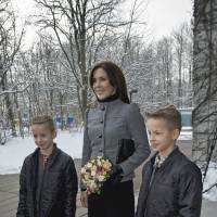 Exactly alike, yet very different: Denmark's Crown Princess Mary, shown with her twin sons Joakim Sejer Poulsen and Jonas, is an ambassador for medical research on twins to determine how environmental and genetic factors impact their health. | AP