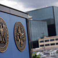 Snoop central: Logos are seen at the National Security Administration campus in Fort Meade, Maryland, Thursday.   AP