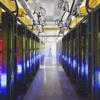 Spy search: Google's campus network room is seen at a data center in Council Bluffs, Iowa. Routers and switches allow Google's data centers to talk to each other. | AP