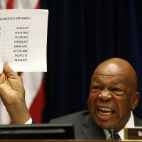 Case closed?: Rep. Elijah Cummings, ranking Democrat on the  House Oversight and Government Reform Committee, holds up a sheet detailing IRS conference spending as he makes opening remarks on Capitol Hill in Washington on  Thursday.   AP