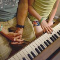 After the violence: Mark Barden and his daughter Natalie, 11, go over her piano lessons together at their home in Newtown, Connecticut, on May 23. | THE WASHINGTON POST