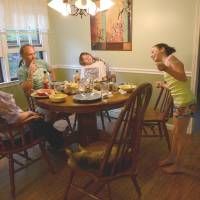 Jackie, Mark and James Barden listen to Natalie tell a story at the family dinner table. | THE WASHINGTON POST