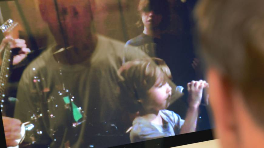 Mark Barden watches a video of Daniel singing at an event. | THE WASHINGTON POST