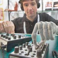 Bionic man: Born without a left hand, Bertolt Meyer received a bionic hand developed by Scottish company Touch Bionics at the age of 19. Here he operates a music console in 2010 at the Orthopedic and Rehabilitation Technology fair in Germany.   AP