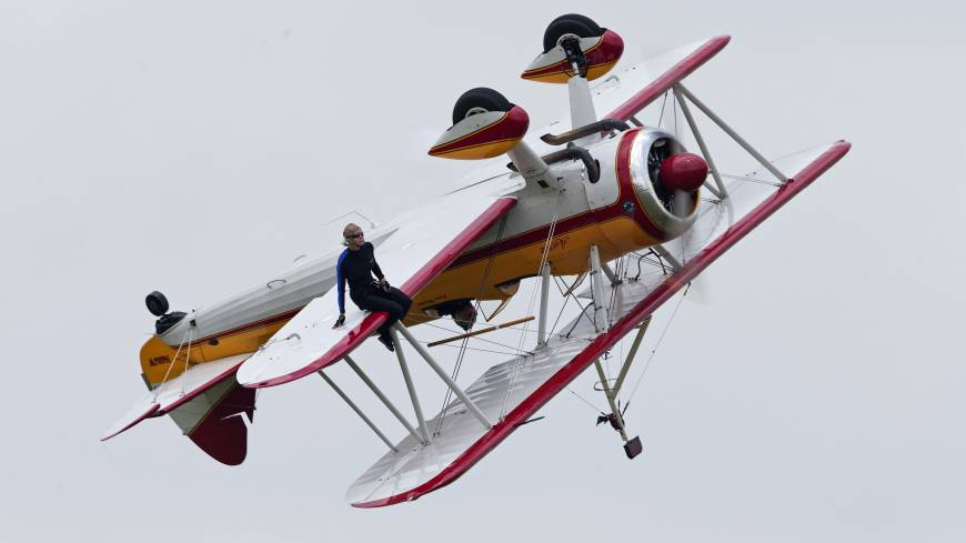 Air show tragedy: Wing walker Jane Wicker performs at the Vectren Air Show just before the plane crashed Saturday in Dayton, Ohio. | AP