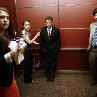 G-Rand ambitions?: Kentucky Sen. Rand Paul rides in an elevator with reporters and staff members after speaking at the Faith and Freedom Coalition Road to Majority Conference in Washington on June 13. | AP