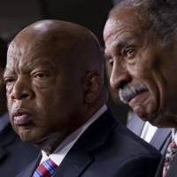 Witnesses: Rep. John Lewis, a Democrat from Georgia (left), and Rep. John Conyers, Democrat from Michigan (right), the co-chairs of the Civil Rights Taskforce of the Congressional Black Caucus, express disappointment in the Supreme Court's decision on Shelby County v. Holder that invalidates Section 4 of the Voting Rights Act on Tuesday on Capitol Hill. Lewis, a prominent activist in the Civil Rights Movement, recalled being attacked and beaten trying to help people in Mississippi register to vote in the 1960s. | AP
