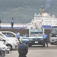 Dangerous load: Policemen provide security Thursday as a ship from France arrives bringing reprocessed nuclear fuel for Kansai Electric Power Co.'s nearby Takahama nuclear plant. | AFP-JIJI