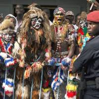 Dakar rally: People dressed in traditional costume and body paint line the motorcade route of U.S. President Barack Obama before his meeting with Senegalese President Macky Sall at the presidential palace in Dakar on  Thursday. Obama is visiting Senegal, South Africa and Tanzania on a weeklong trip to Africa. | AP