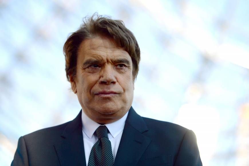 Tapie charged as French probe takes new twist