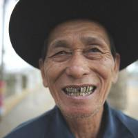 Several years left: An elderly man has a laugh outside a tea house in Chengmai, Hainan province, in January. | AFP-JIJI