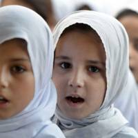 Learning: Pakistani girls attend a school assembly in Mingora, the main town in the Swat Valley, on June 21. | AFP-JIJI